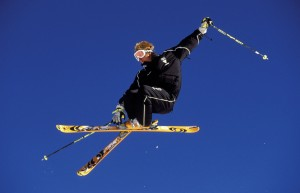 Free-riding skier getting some air